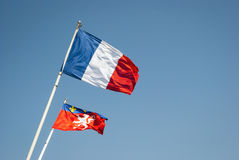 Vawing flag of France and Lyon city Stock Images