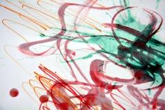 Vaxartad rosa röd grön målarfärgabstrakt begreppbakgrund Arkivfoton