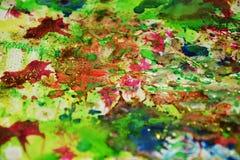 Vaxartade färgstänk för gräsplanblåttapelsin, abstrakt idérik bakgrund för målarfärg Arkivfoton