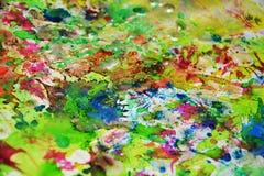 Vaxartade färgstänk för vattenfärg, abstrakt idérik bakgrund Arkivbilder