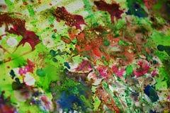 Vaxartade färgstänk för vattenfärgmålarfärg, abstrakt idérik bakgrund Royaltyfri Bild