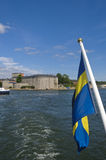 Vaxholm fortress and Swedish flag Royalty Free Stock Photo