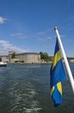 Vaxholm fortress and Swedish flag royalty free stock photo