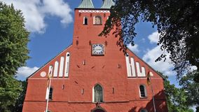 Vaxjo Cathedral. The lofty copper clad twin spires of Vaxjo cathedral gives the city a very special profile. The cathedral dates back to the late 12th century stock footage