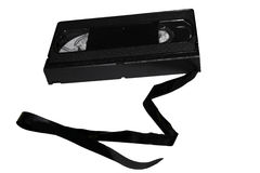 VCR Tape. A VCR tape cassette with a broken string of film tape Royalty Free Stock Images