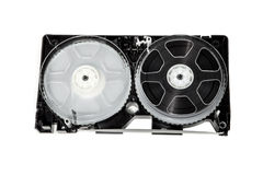 VCR Tape Reels. Video cassette tape against a white background Royalty Free Stock Image