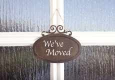 We've moved. A sign on a door with the text we have moved Stock Photos