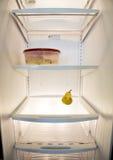 Vea dentro de interior vacío del refrigerador con casi ninguna comida Fotografía de archivo libre de regalías