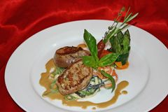 Veal. Medailllions with pasta and asparagus Stock Images