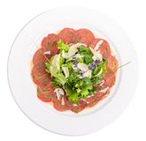 Veal carpaccio with fresh herbs and parmesan. Stock Images