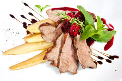 Veal carpaccio. With pear, berries, rosemary and mint twig stock photos