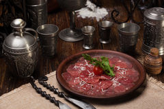 Veal carpaccio with traditional sauce Royalty Free Stock Photos