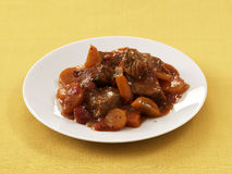 Veal and carrot stew in tomato sauce Stock Image