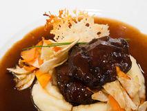 Veal cheeks with mashed potatoes Stock Images