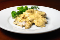 Veal with cheese sauce on plete Stock Photography