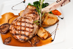 Veal Chop. Broiled center cut veal chop with sauteed onions and mushrooms Stock Photography