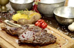 Veal chop. S, tomato black pepper and rock salt has served on natural wood royalty free stock photos