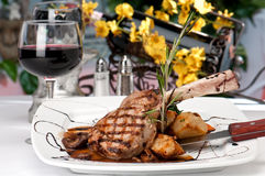 Veal Chop Dinner And Wine Royalty Free Stock Photos