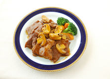 Veal chop with oyster sauce Stock Photos