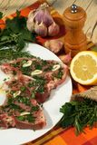 Veal chops. Seasoned with fresh herbs, olive oil, garlic, salt and pepper, ready for cooking Stock Photo