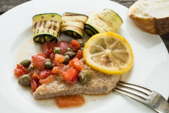 Veal cutlet with tomatoes and capers Royalty Free Stock Photography