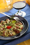 Veal cutlets. With red wine and herbs Royalty Free Stock Photo