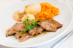 Veal dish. Veal scallopini with potatoes and mashed root vegetables Stock Image