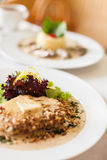 Veal fillet with a creamy souce made of Dorblu cheese and walnut Stock Photos