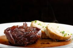 Veal fillet with rich sauce and bread dumplings Stock Images