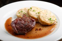 Veal fillet with rich sauce and bread dumplings Stock Photo