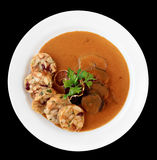 Veal fillet with rich sauce and dumplings, isolated Royalty Free Stock Photography