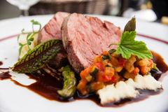 Veal fillet with vegetable ratatouille Stock Photos