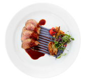 Veal fillet with violet botato mash, sweetbread and grilled vege Stock Photos