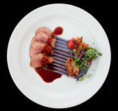 Veal fillet with violet potato mash, sweetbread and vegetables Royalty Free Stock Images