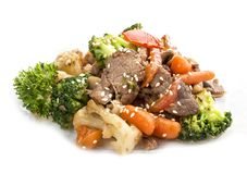 Veal, fried in WOK with vegetables in soy sauce royalty free stock images
