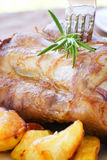 Veal knuckle with potatoes Stock Photos