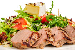 Veal meat with fresh vegetable salad Royalty Free Stock Image