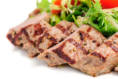 Veal meat with fresh vegetable salad Stock Photography
