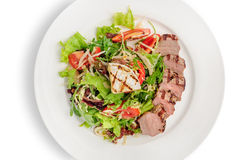 Veal meat with fresh vegetable salad Royalty Free Stock Images