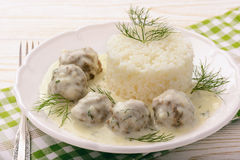 Veal meatballs with dill sauce and boiled rice. Royalty Free Stock Photo