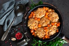 Veal meatballs stewed in frying pan with carrot in vegetable sauce. Delicious meat dish. Top view stock photos