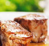Veal Medallions. With Greens on a Background. Selective Focus Royalty Free Stock Image