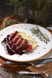 Veal medallions with mashed potatoes and sauce Royalty Free Stock Photography