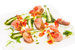 Veal medallions with pesto sauce Stock Photo