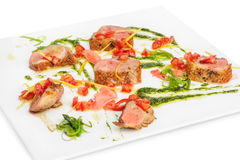 Veal medallions with pesto sauce Royalty Free Stock Photography