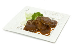 Veal medallions on plate isolated Royalty Free Stock Photos