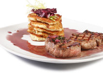 Veal Medallions with potato pancakes. With sauce and salad. Closeup Royalty Free Stock Image