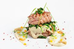 Veal Medallions With Spinach Stock Image