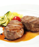Veal Medallions with Zucchini Stock Image