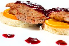 Veal with orange under the currant sauce Royalty Free Stock Photos
